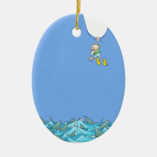 Cartoon illustration of a man hanging over sharks. ceramic oval decoration