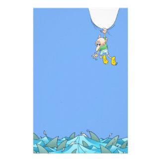 Cartoon illustration of a man hanging over sharks. stationery