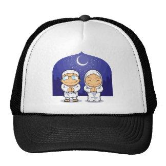 Cartoon of Muslim Man Woman Greeting Ramadan Hats