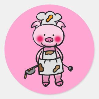 Cartoon pink pig chef round sticker