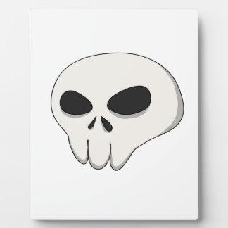 cartoon skull plaque