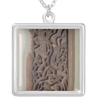 Carved panel decorated with a lute player silver plated necklace