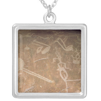 Carved petroglyph depicting figures silver plated necklace