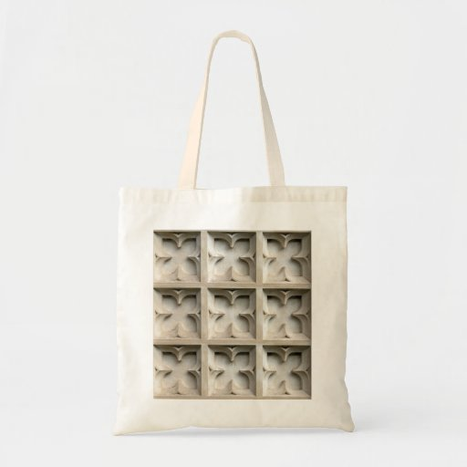 Carved stone panels tote bags
