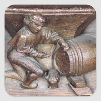 Carving depicting a man putting a tap on barrel square sticker