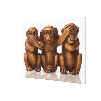 Carving of three wooden monkeys canvas print