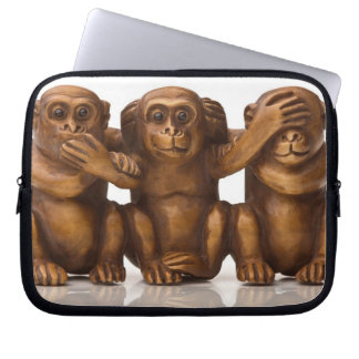 Carving of three wooden monkeys laptop sleeve