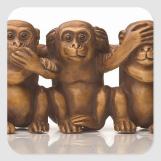 Carving of three wooden monkeys square sticker