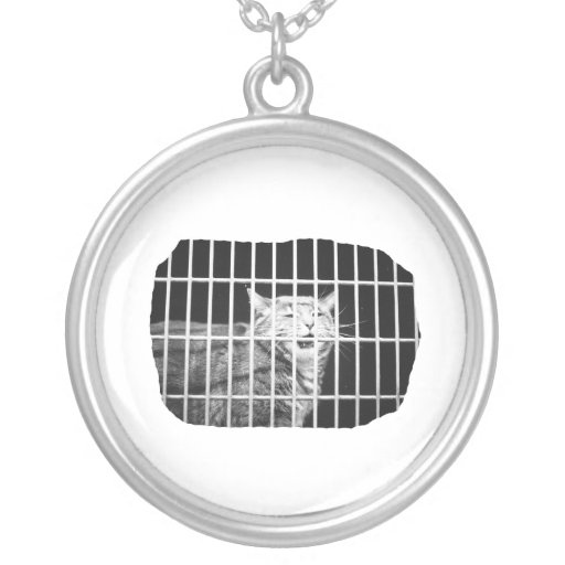Cat behind bars with mouth open mean kitty jewelry