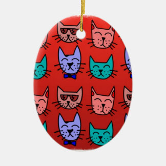 Cat faces on red christmas ornament