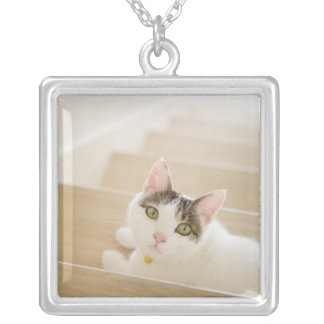 Cat lying on stairs square pendant necklace