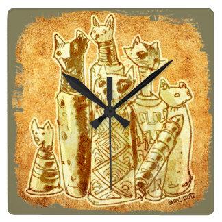 cat mummies yellow sand clock