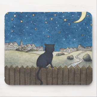 Cat on a fence looking at night sky above city mouse pads