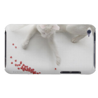 Cat playing with heart shaped candy iPod touch cases