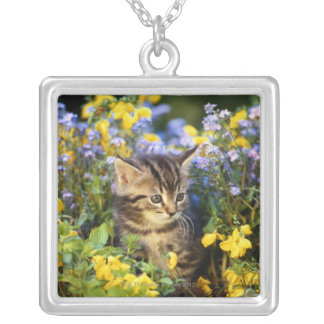 Cat sitting in flower garden silver plated necklace