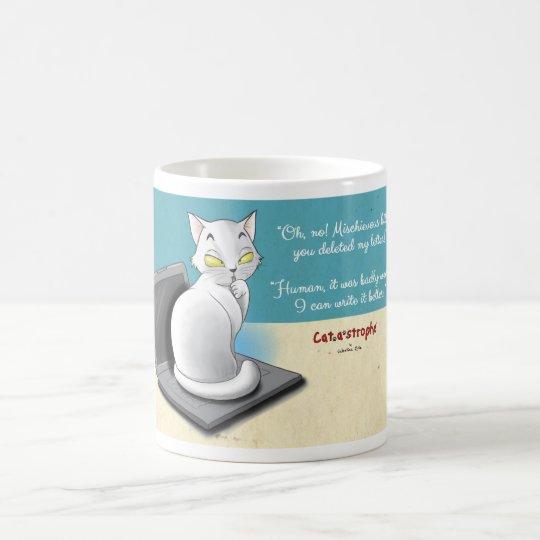 Cat sitting on a laptop coffee mug