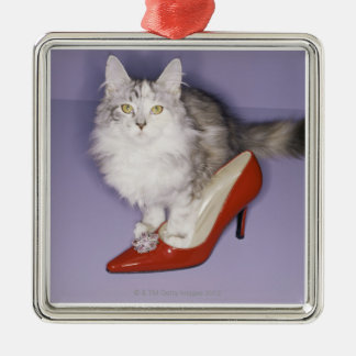 Cat stepping into high heel christmas ornament