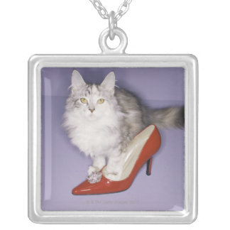 Cat stepping into high heel silver plated necklace