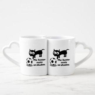 Cat with football lovers mug