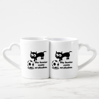 Cat with football couple mugs