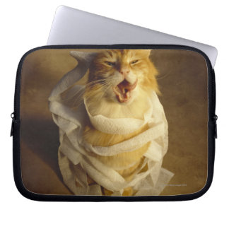 Cat wrapped in medical gauze laptop sleeve