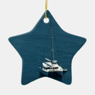 Catamaran moored offshore christmas ornament