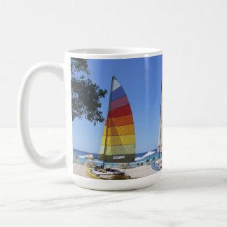Catamarans And Lifeguard Stand On Beach Coffee Mug