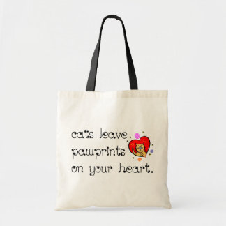 Cats leave pawprints on your heart. bags