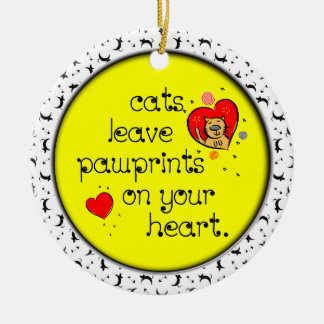 Cats leave pawprints on your heart. round ceramic decoration