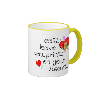 Cats leave pawprints on your heart. coffee mug