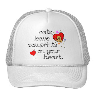 Cats leave pawprints on your heart. trucker hat