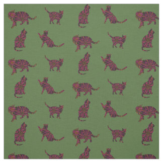 Cats on green fabric