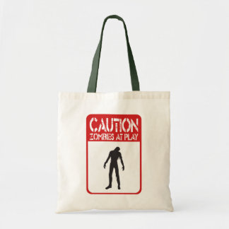 Caution zombies at play tote bags