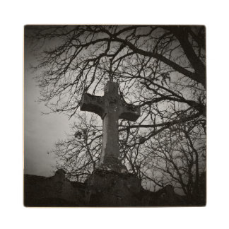 Cemetery grave cross sheltered by tree branches wood coaster