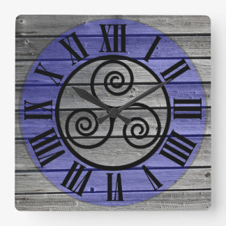 Centered Triskelion On Aged Wood Image and Blue Square Wall Clock