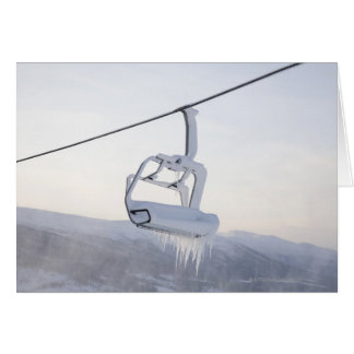 Chair lift full of snow and ice card
