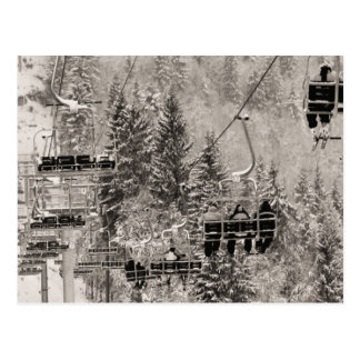 Chairlifts above the trees postcard
