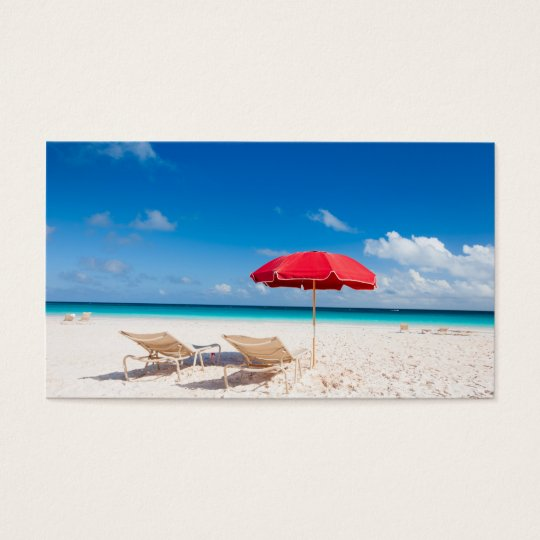 Chairs and umbrellas on a tropical beach business card