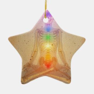Chakras over a human body christmas ornament