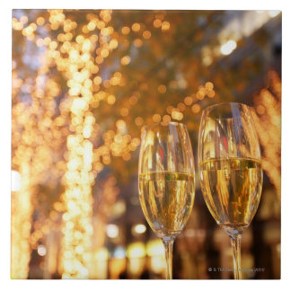 Champagne glasses toasting Christmas on city Large Square Tile
