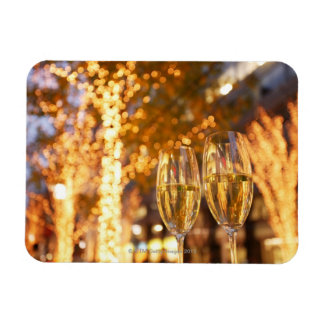 Champagne glasses toasting Christmas on city Rectangular Photo Magnet