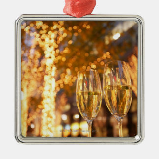 Champagne glasses toasting Christmas on city Silver-Colored Square Decoration