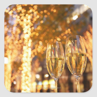 Champagne glasses toasting Christmas on city Square Sticker