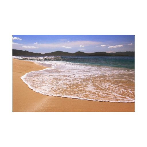 Champagne seas on a sunny island beach stretched canvas prints