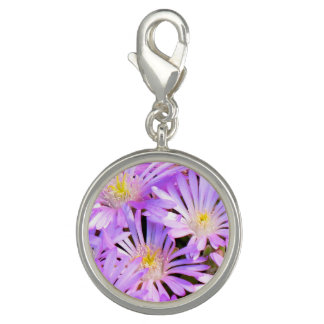 Charm with purple flowers close up
