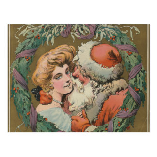 Charming Vintage Kissing Santa Christmas Wreath Postcard