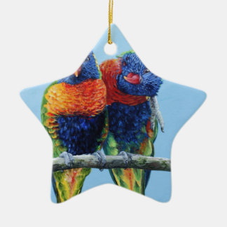 Cheeky colourful Rainbow lorikeets preening each Christmas Ornament