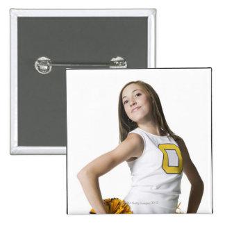 Cheerleader holding pom-poms 15 cm square badge