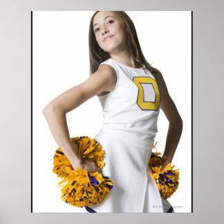 Cheerleader holding pom-poms poster