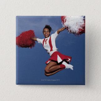 Cheerleader in mid-air 15 cm square badge